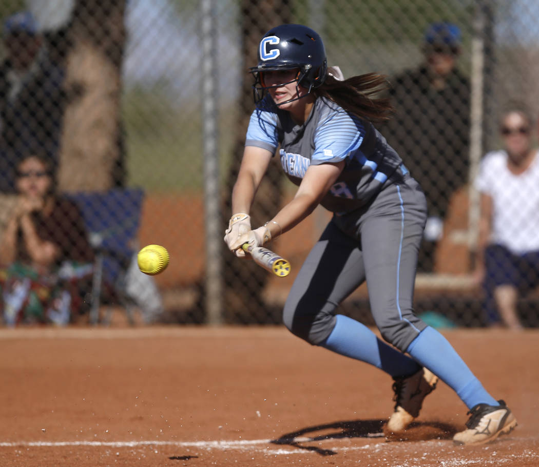 Centennial's Haylee Lupinetti (8) bunts during the second inning of a high school softball game against Palo Verde at Palo Verde High School on Monday, April 3, 2017, in Las Vegas. Palo Verde won  ...