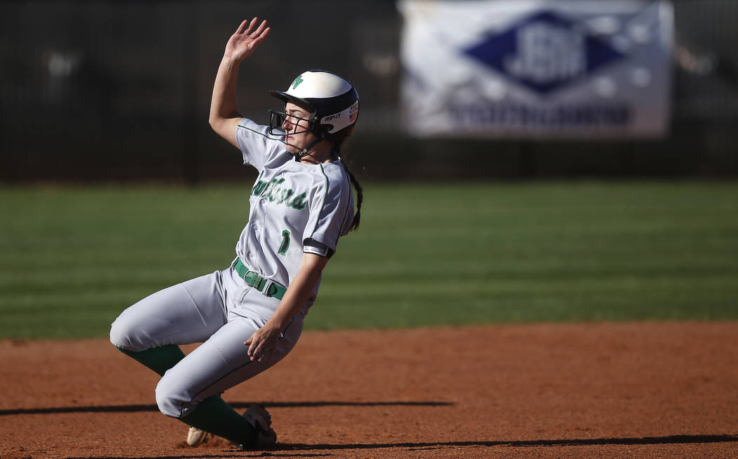 Palo Verde's Makall Whetten (1) slides for second base during the third inning of a high school softball game against Centennial at Palo Verde High School the on Monday, April 3, 2017, in Las Vega ...