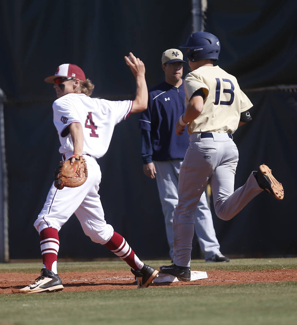 Desert Oasis's Parker Schmidt (4) tags the base forcing Spring Valley's Kade Higgins (13) out during the first inning of a high school baseball game at  Desert Oasis High School on Tuesday, April  ...