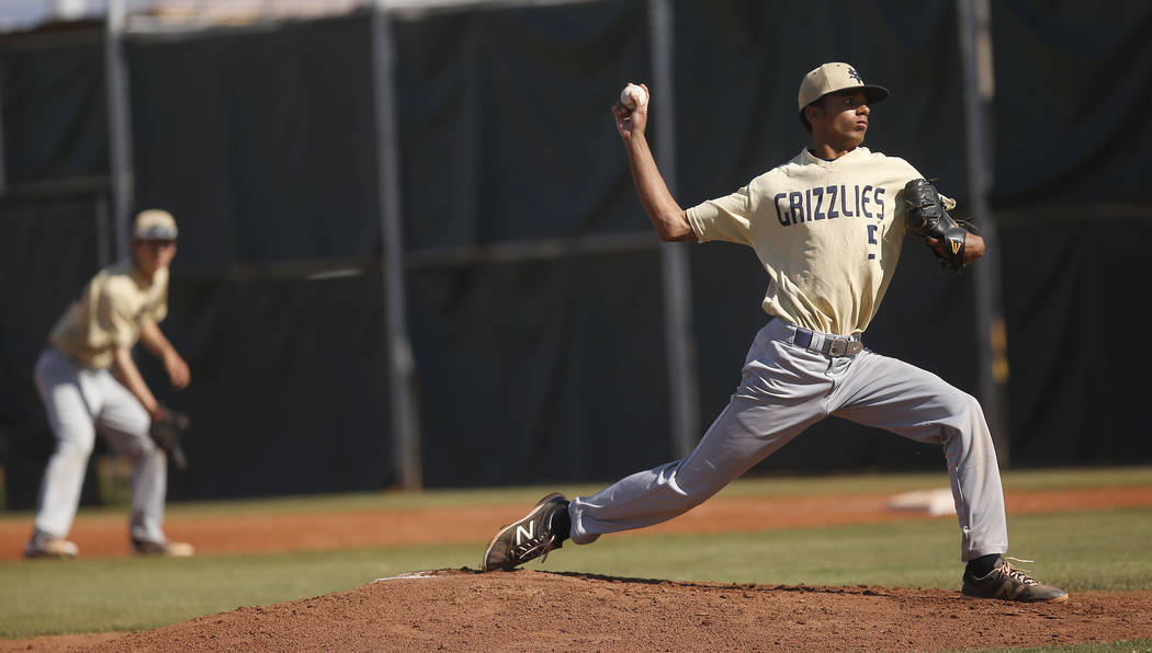 Spring Valley's Jaxson Otis (5) pitches during the first inning of a high school baseball game against Desert Oasis at  Desert Oasis High School on Tuesday, April 4, 2017, in Las Vegas. Spring Val ...