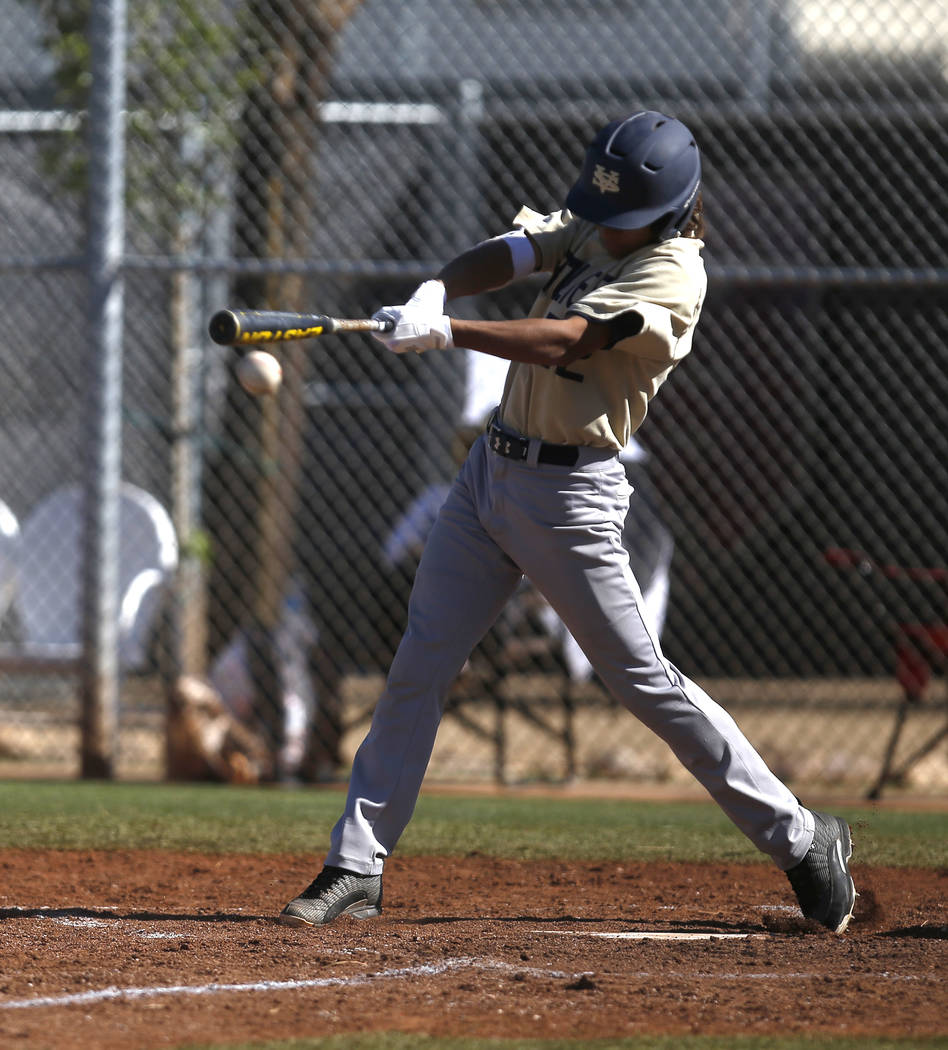 Spring Valley's Chase Rodriguez (22) swings during the third inning of a high school baseball game against Desert Oasis at Desert Oasis High School on Tuesday, April 4, 2017, in Las Vegas. Spring  ...