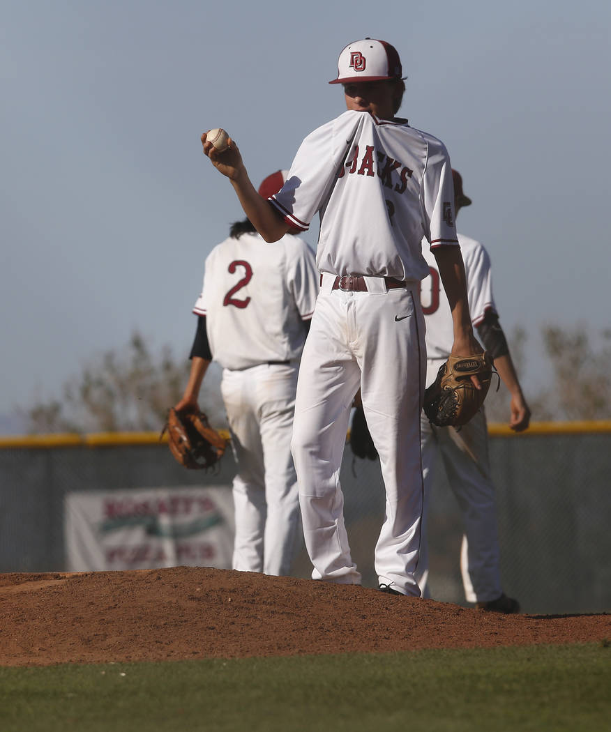 Desert Oasis's Dustin Mansell (8) walks to the base as a relief pitched during the sixth inning of a high school baseball game at  Desert Oasis High School on Tuesday, April 4, 2017, in Las Vegas. ...