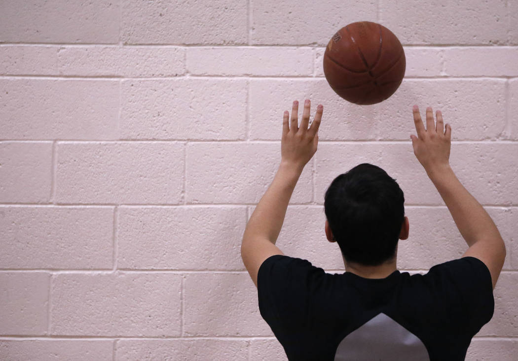 Senior setter Edher Aldaco practice his setting skills with a basketball during volleyball practice at Cimarron-Memorial High School on Friday, March 31, 2017, in Las Vegas. Christian K. Lee Las V ...