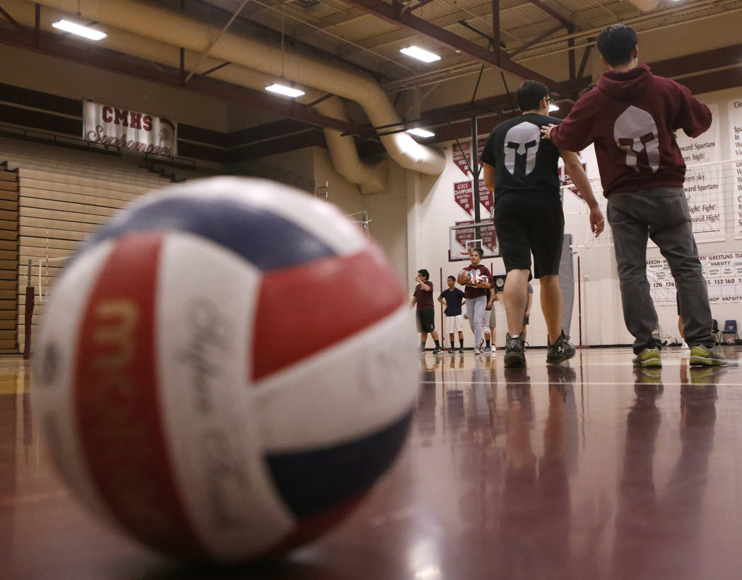 Head coach Sopheap Khuon speaks to the volleyball team during practice at Cimarron-Memorial High School on Friday, March 31, 2017, in Las Vegas. Christian K. Lee Las Vegas Review-Journal @chriskle ...