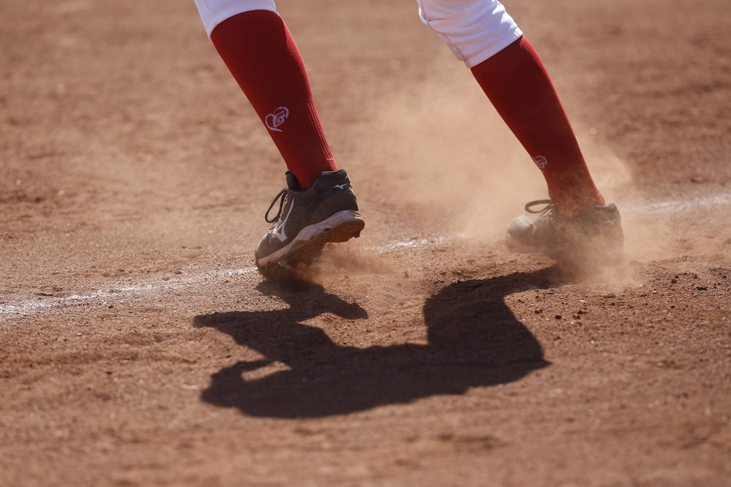 Dust flies as a player leads off third base during a high school softball game at Coronado High School on Saturday, April 1, 2017, in Henderson. (Christian K. Lee/Las Vegas Review-Journal) @chrisk ...