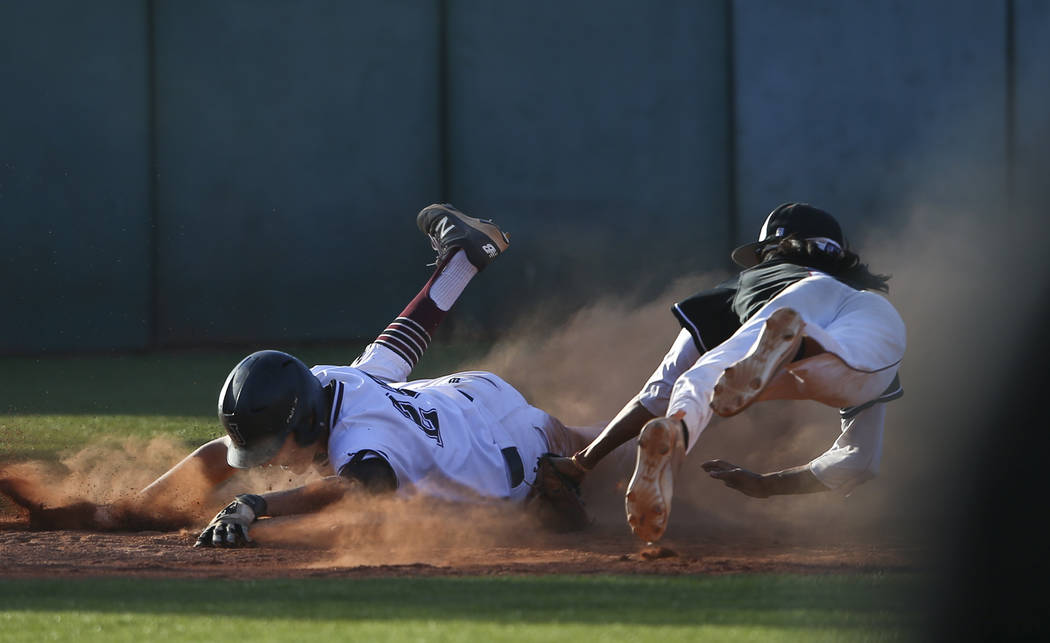 Jordan's Robbie Gallo (24) slides safely into third base as Desert Oasis' Andrew Martinez (2) attempts to tag him out during the Bishop Gorman Desert Classic at Bishop Gorman High School in Las Ve ...