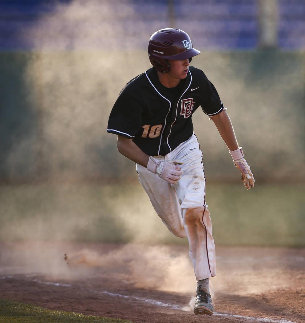 Desert Oasis' Cole Schaefer (10) runs for first base against Jordan during the Bishop Gorman Desert Classic at Bishop Gorman High School in Las Vegas on Saturday, April 8, 2017. Desert Oasis won 6 ...