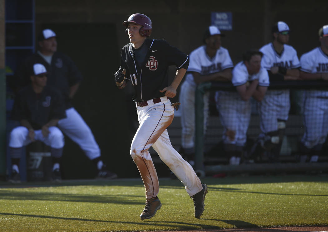 Desert Oasis' Brett Brocoff (11) heads to home base to score a run against Jordan during the Bishop Gorman Desert Classic at Bishop Gorman High School in Las Vegas on Saturday, April 8, 2017. Dese ...