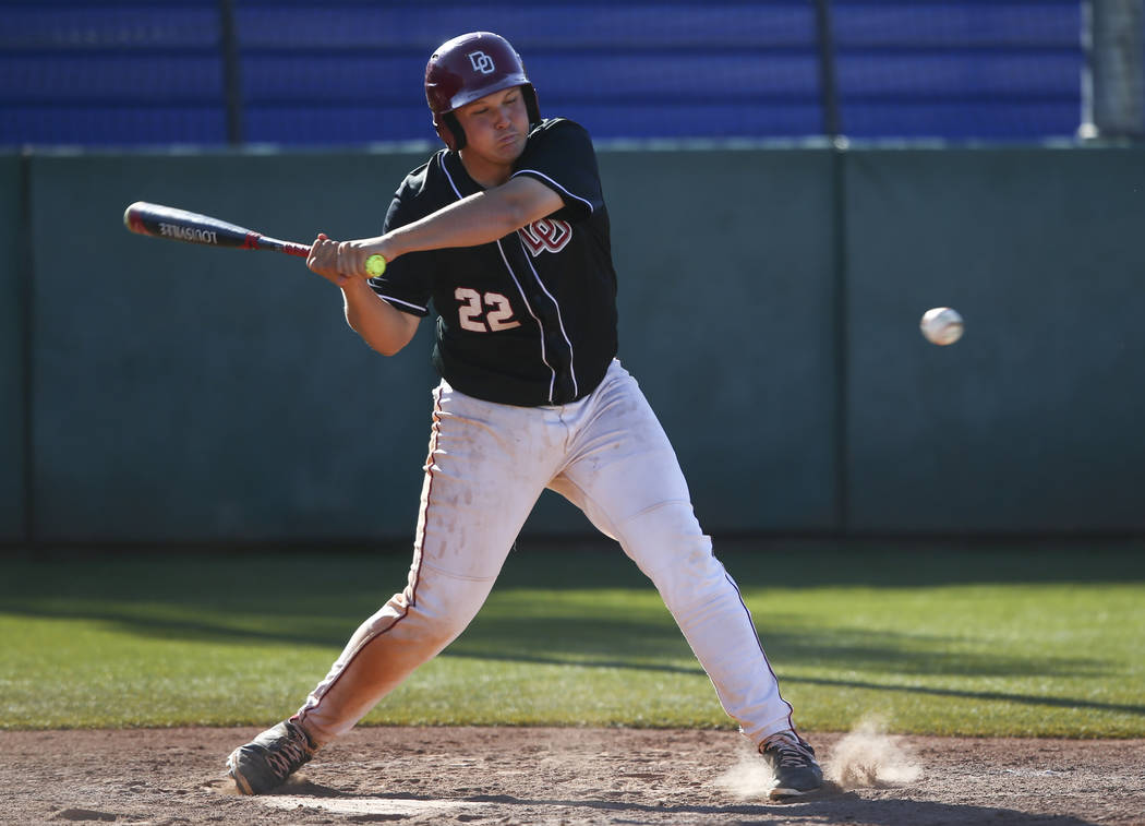 Desert Oasis' Chaison Miklich (22) swings at a pitch from Jordan during the Bishop Gorman Desert Classic at Bishop Gorman High School in Las Vegas on Saturday, April 8, 2017. Desert Oasis won 6-3. ...