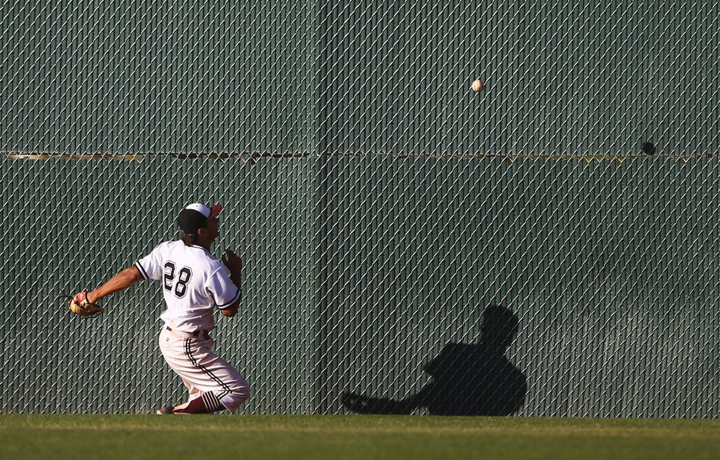 Jordan's Hunter Swapp (28) comes up short on a fly ball from Desert Oasis during the Bishop Gorman Desert Classic at Bishop Gorman High School in Las Vegas on Saturday, April 8, 2017. Desert Oasis ...