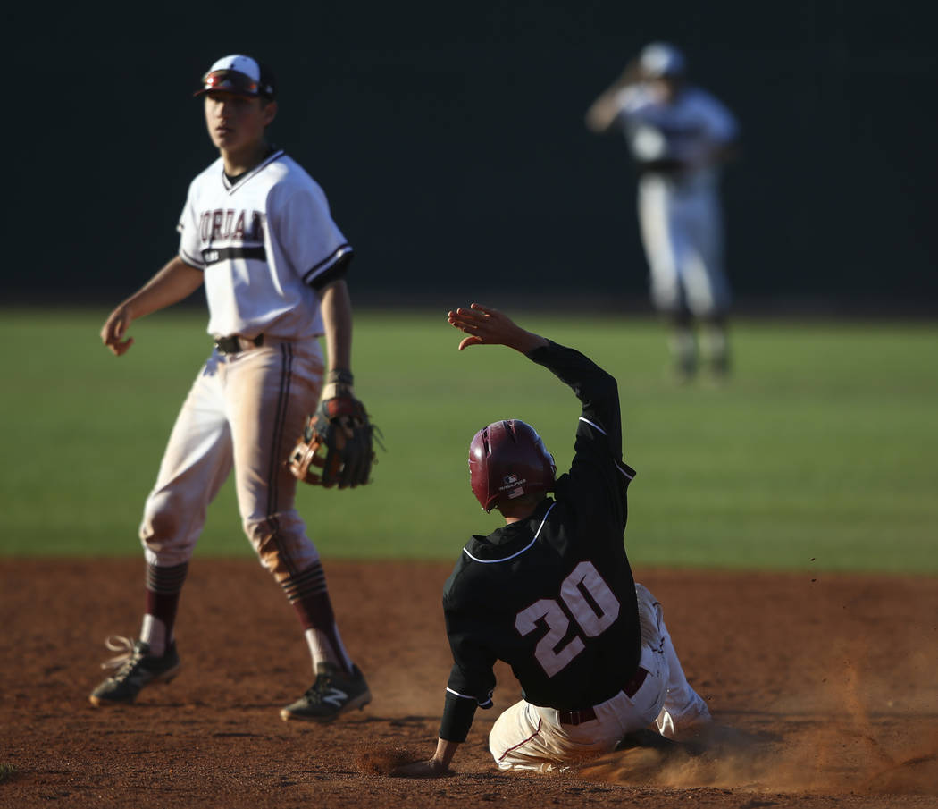 Desert Oasis' Jordan DeMarce (20) slides into second base against Jordan's Robbie Gallo (24) during the Bishop Gorman Desert Classic at Bishop Gorman High School in Las Vegas on Saturday, April 8, ...