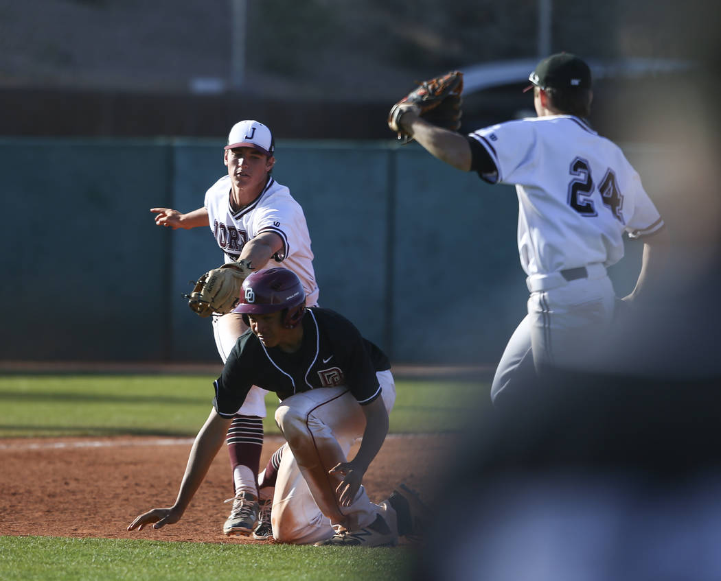 Desert Oasis' Aaron Roberts (25) gets tagged out by Jordan's Noah Hennings (5) during the Bishop Gorman Desert Classic at Bishop Gorman High School in Las Vegas on Saturday, April 8, 2017. Desert  ...