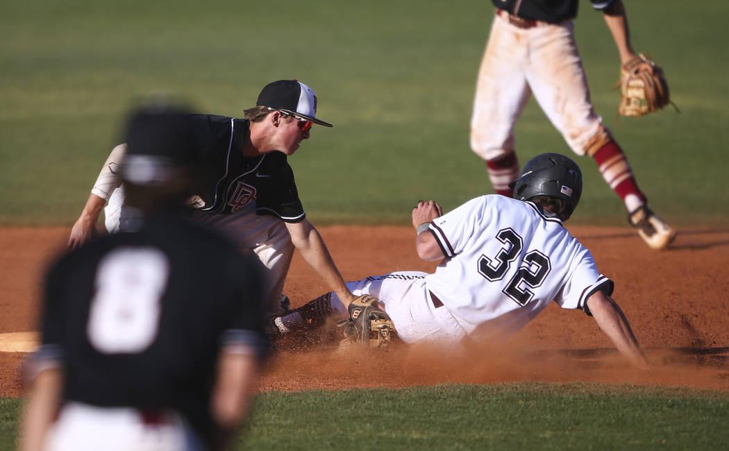 Desert Oasis' Cole Schaefer (10) tags out Jordan's Jacob Shaver (32) at second base during the Bishop Gorman Desert Classic at Bishop Gorman High School in Las Vegas on Saturday, April 8, 2017. De ...