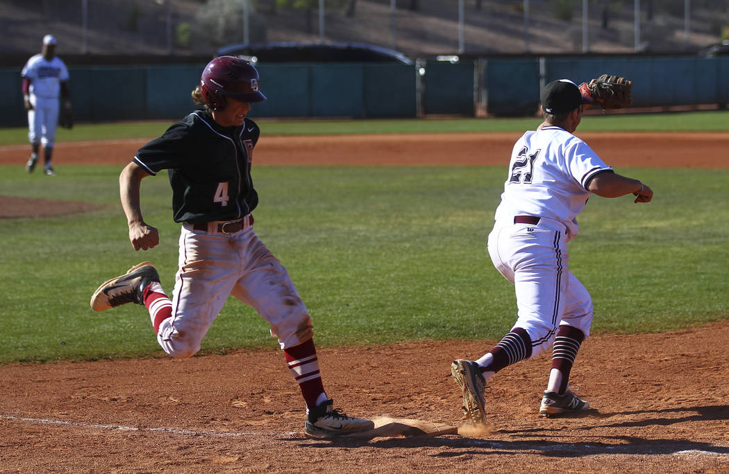 Desert Oasis' Parker Schmidt (4) gets tagged out at first base by Jordan's Gage Carson (21) during the Bishop Gorman Desert Classic at Bishop Gorman High School in Las Vegas on Saturday, April 8,  ...