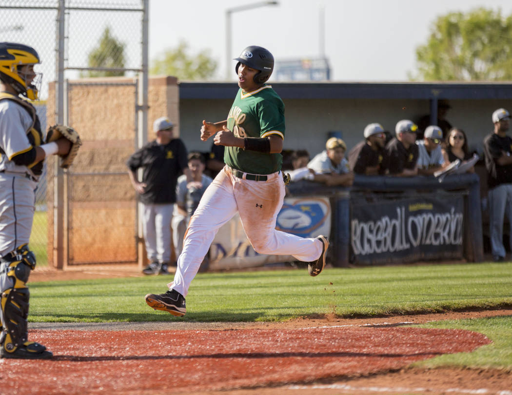 Rancho's Jimmy Gamboa (99) runs to home base during the fifth inning during the game against San Pedro High School (Calif.) at Shadow Ridge High School in Las Vegas Monday, April 10, 2017. Elizabe ...