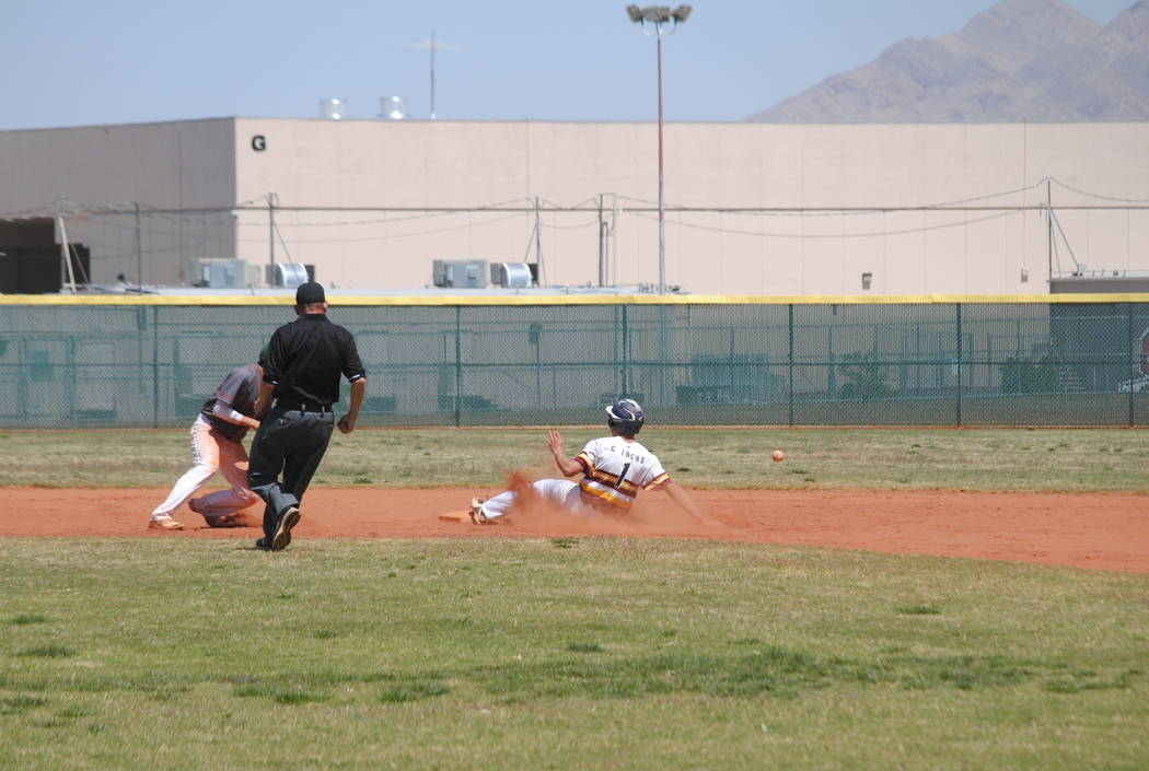 Pahrump Valley's Garrett Lucas slides safely into second base on Wednesday. The Trojans beat Mojave 5-0 to capture the Cowboy Classic title. (Charlotte Uyeno)