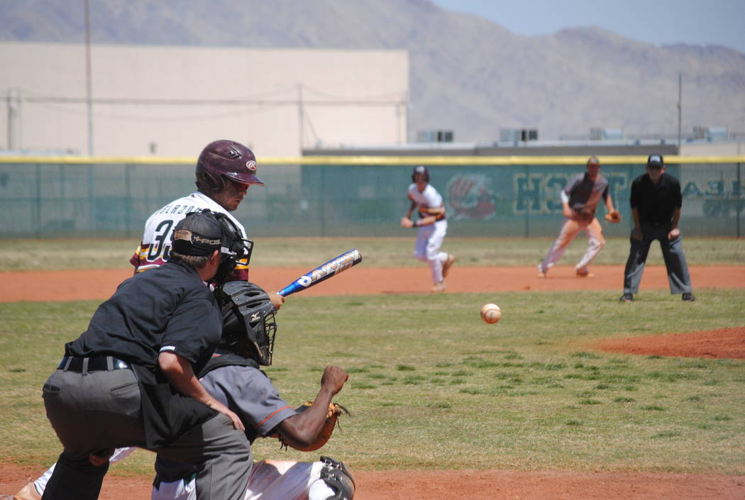 A Pahrump Valley player takes a pitch on Wednesday. The Trojans beat Mojave 5-0 to capture the Cowboy Classic title. (Charlotte Uyeno)