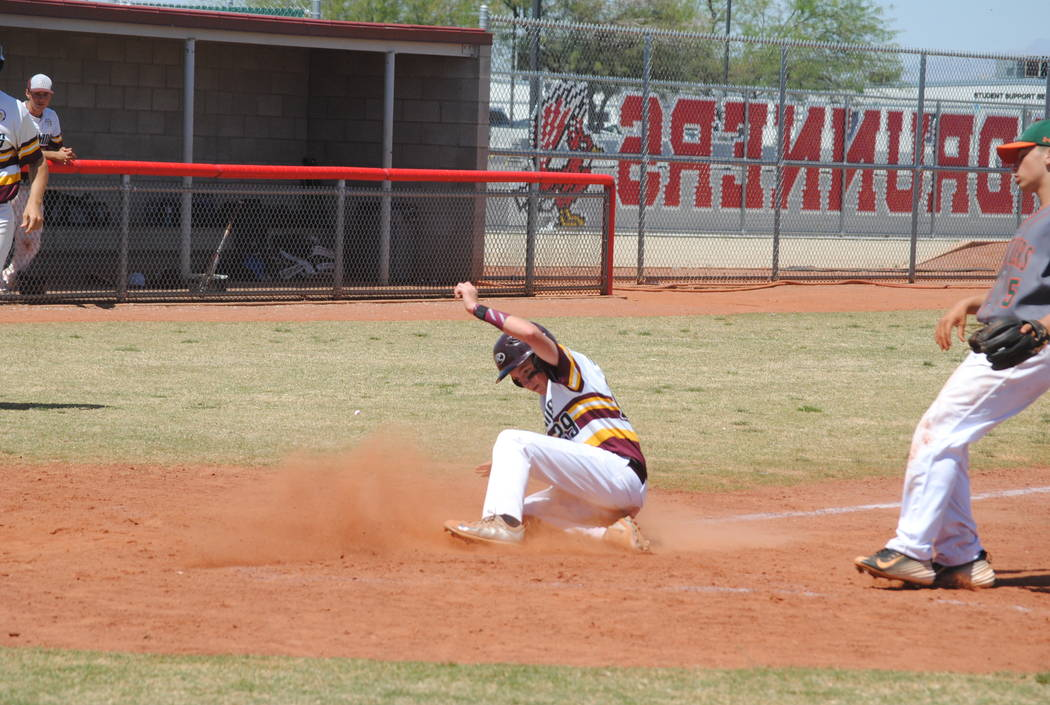 A Pahrump Valley player slides across the plate to score a run on Wednesday. The Trojans beat Mojave 5-0 to capture the Cowboy Classic title. (Charlotte Uyeno)