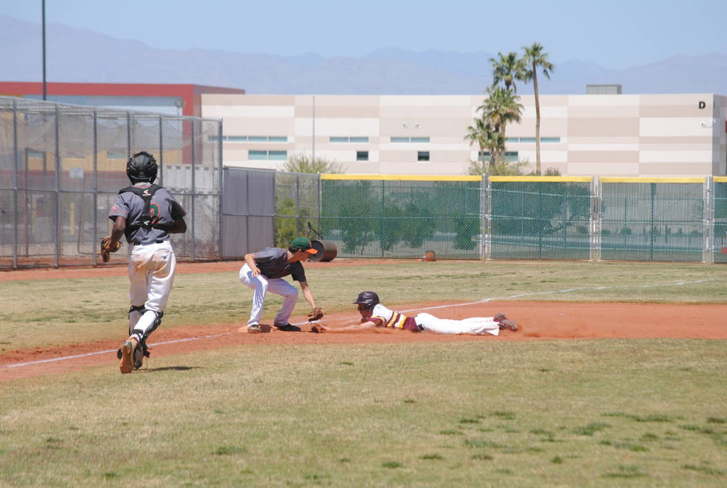 A Pahrump Valley player attempts to slide into third base on Wednesday. The Trojans beat Mojave 5-0 to capture the Cowboy Classic title. (Charlotte Uyeno)