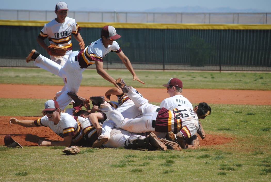 Pahrump Valley players celebrate Willie Lucas' no-hitter on Wednesday. The Trojans beat Mojave 5-0 to capture the Cowboy Classic title. (Charlotte Uyeno)