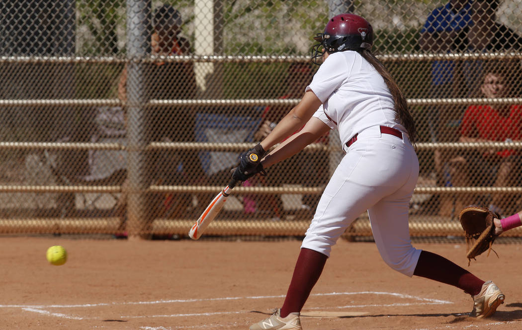 Desert Oasis's Meaghan McInerney (21) swings during a high school softball game at Majestic Park on Thursday, April 13, 2017, in Las Vegas. Basic won 5-2. Christian K. Lee Las Vegas Review-Journal ...