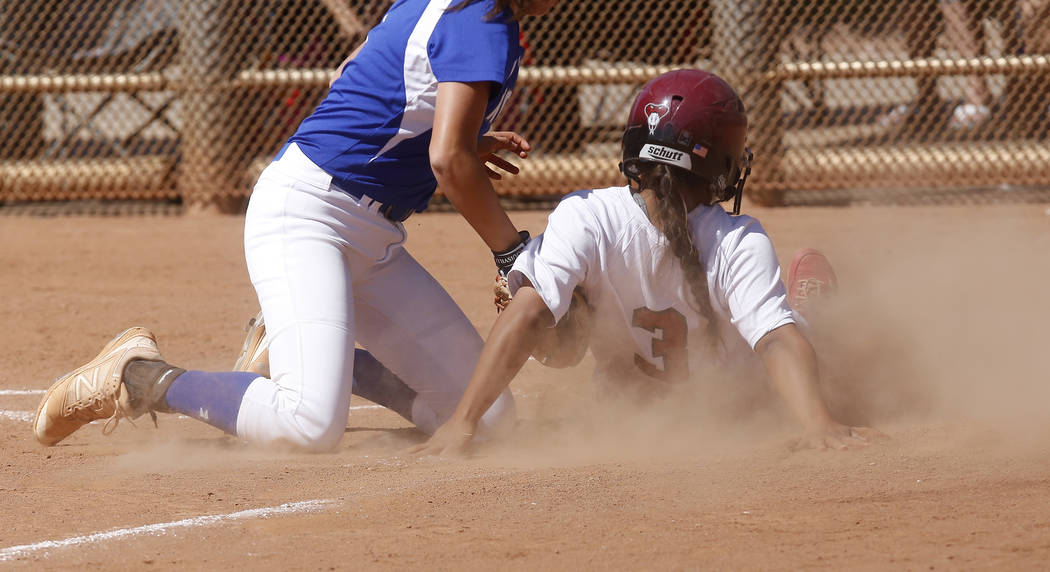 Desert Oasis's Izriah Hodson (3) is tagged out during a high school softball game at Majestic Park on Thursday, April 13, 2017, in Las Vegas. Basic won 5-2. Christian K. Lee Las Vegas Review-Journ ...