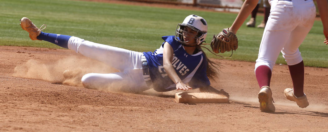 Basic's Alyssa Ferguson (21) is safe at first base during a high school softball game at Majestic Park on Thursday, April 13, 2017, in Las Vegas. Basic won 5-2. Christian K. Lee Las Vegas Review-J ...