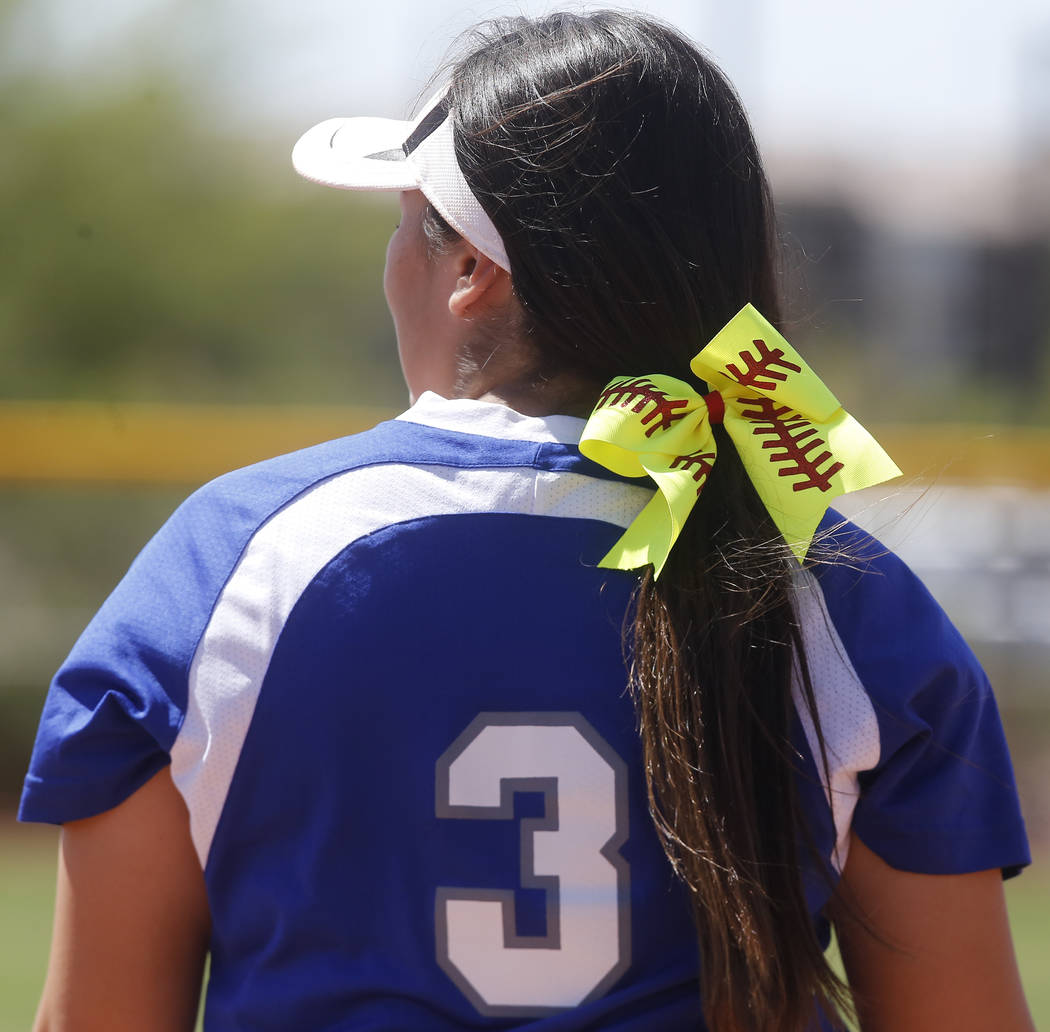 A softball themed ribbon in the hair of Basic's Adalena Clayton (3) during a high school softball game at Majestic Park on Thursday, April 13, 2017, in Las Vegas. Basic won 5-2. Christian K. Lee L ...