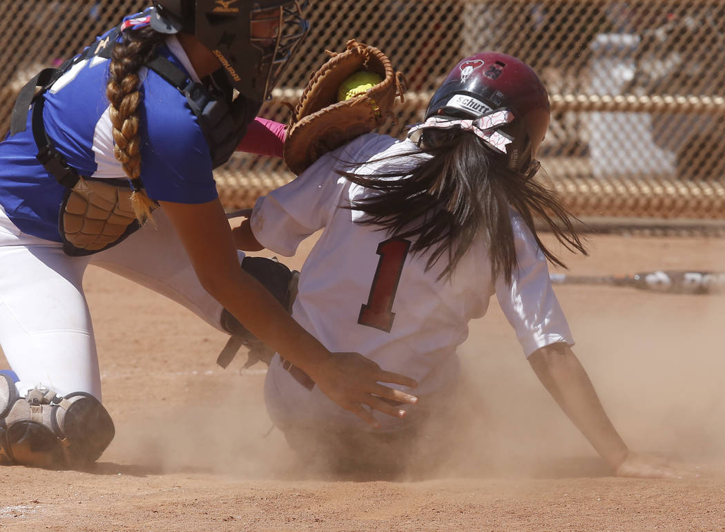 Desert Oasis's Yahirda Pelegrina (1) is tagged out at home plate during a high school softball game at Majestic Park on Thursday, April 13, 2017, in Las Vegas. Basic won 5-2. Christian K. Lee Las  ...