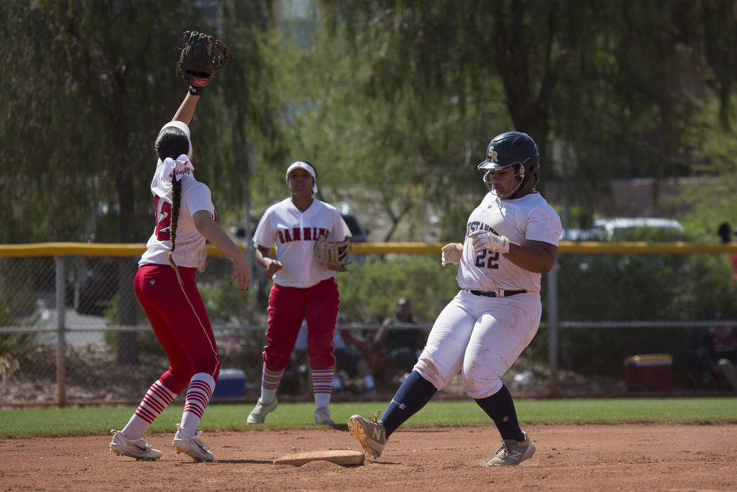 Shadow Ridge sophomore Alyssa Stanley safely makes it to second base during their game against Banning at Majestic Park in part of the Spring Jamboree softball tournament on Saturday, April 15, 20 ...