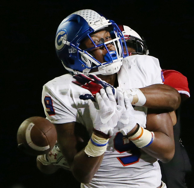 Bishop Gorman wide receiver Brevin Jordan (9) is unable to make a catch while being defended by Cedar Hill free safety Josh Newman (14) in the first half during a high school football game between ...