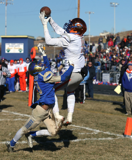 Bishop Gorman's Brevin Jordan makes a touchdown reception over Reed defender Kyeer Geisinger during an NIAA Division I playoff game at Reed High School in Sparks, Nev., on Saturday, Nov. 28, 2015. ...