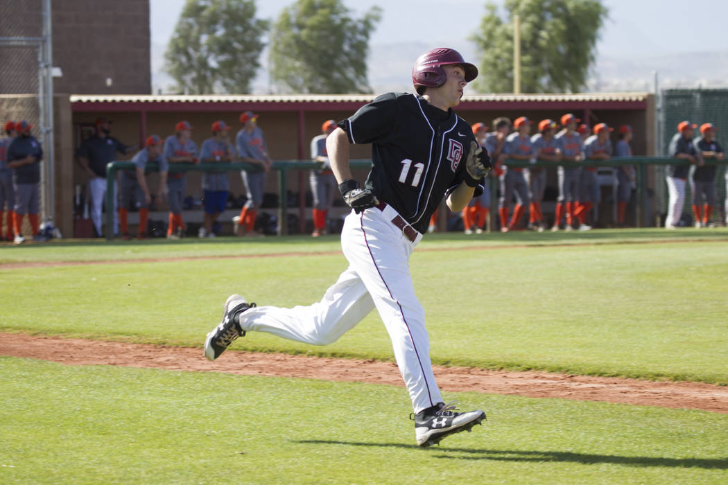 Desert Oasis' Brett Brocoff (11) rounds the bases after hitting a homer against Bishop Gorman at Desert Oasis High School on Tuesday, April 18, 2017, in Las Vegas. Desert Oasis won 5-1. Erik Verdu ...