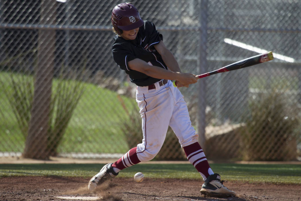Desert Oasis' Cesar Sedano (4) swings the bat against Bishop Gorman at Desert Oasis High School on Tuesday, April 18, 2017, in Las Vegas. Desert Oasis won 5-1. Erik Verduzco Las Vegas Review-Journ ...