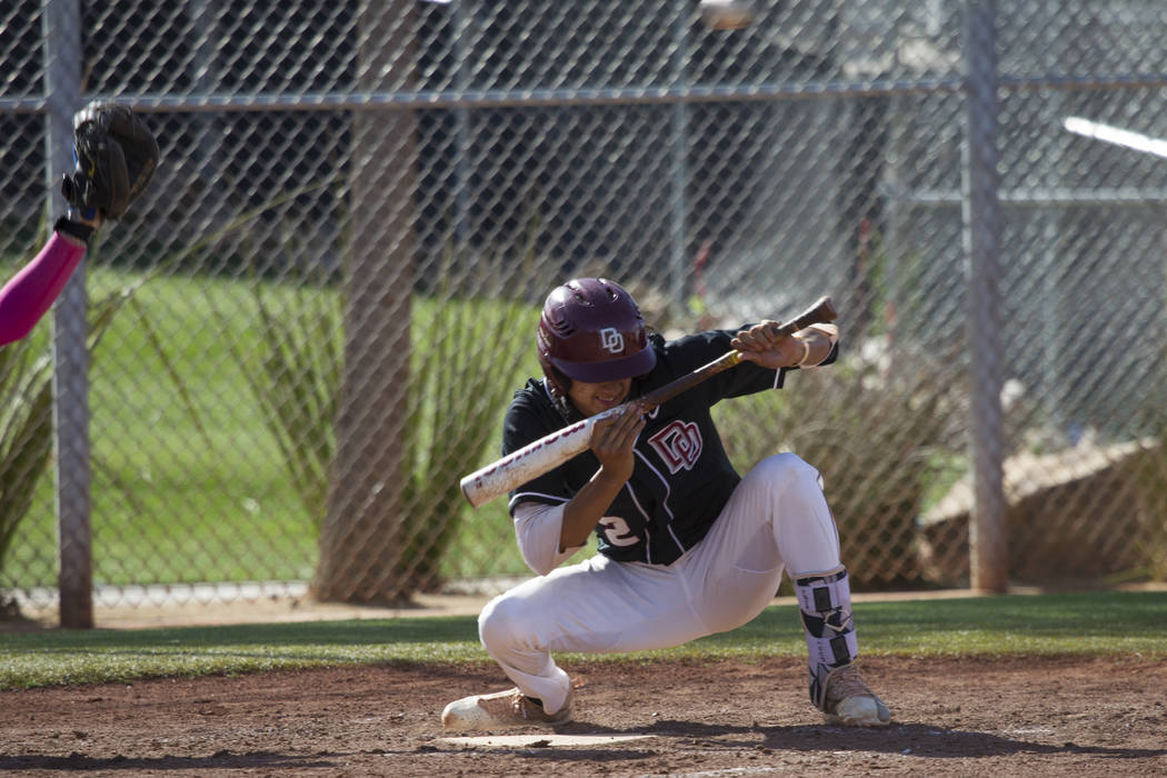 Desert Oasis' Tyler Curtis (2) ducks a low pitch against Bishop Gorman at Desert Oasis High School on Tuesday, April 18, 2017, in Las Vegas. Desert Oasis won 5-1. Erik Verduzco Las Vegas Review-Jo ...