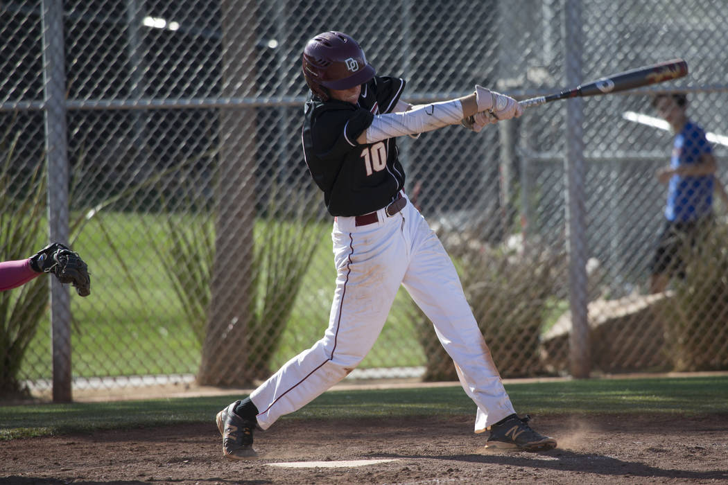 Desert Oasis' Cole Schaefer (10) swings the bat against Bishop Gorman at Desert Oasis High School on Tuesday, April 18, 2017, in Las Vegas. Desert Oasis won 5-1. Erik Verduzco Las Vegas Review-Jou ...