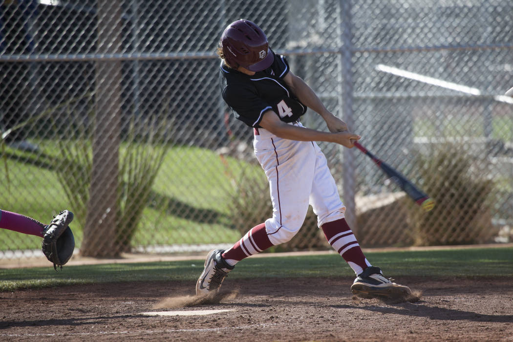 Desert Oasis' Parker Schmidt (4) swings the bat against Bishop Gorman at Desert Oasis High School on Tuesday, April 18, 2017, in Las Vegas. Desert Oasis won 5-1. Erik Verduzco Las Vegas Review-Jou ...