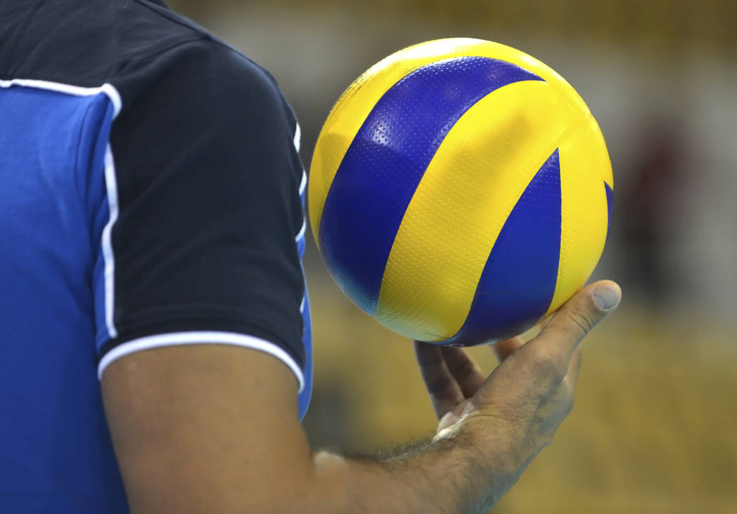 Volleyballplayer with a volleyball in his right hand