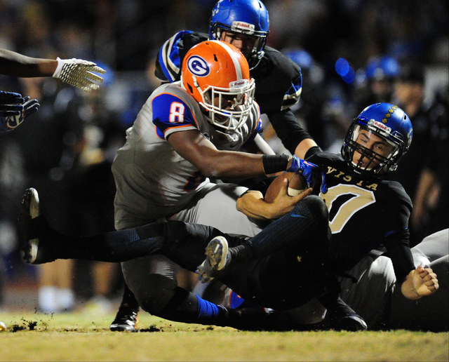 Bishop Gorman defensive end Adam Plant Jr. (8) sacks Sierra Vista quarterback Oscar Aliaga in the first half of their prep football game at Sierra Vista High School in Las Vegas Friday, Nov. 4, 20 ...