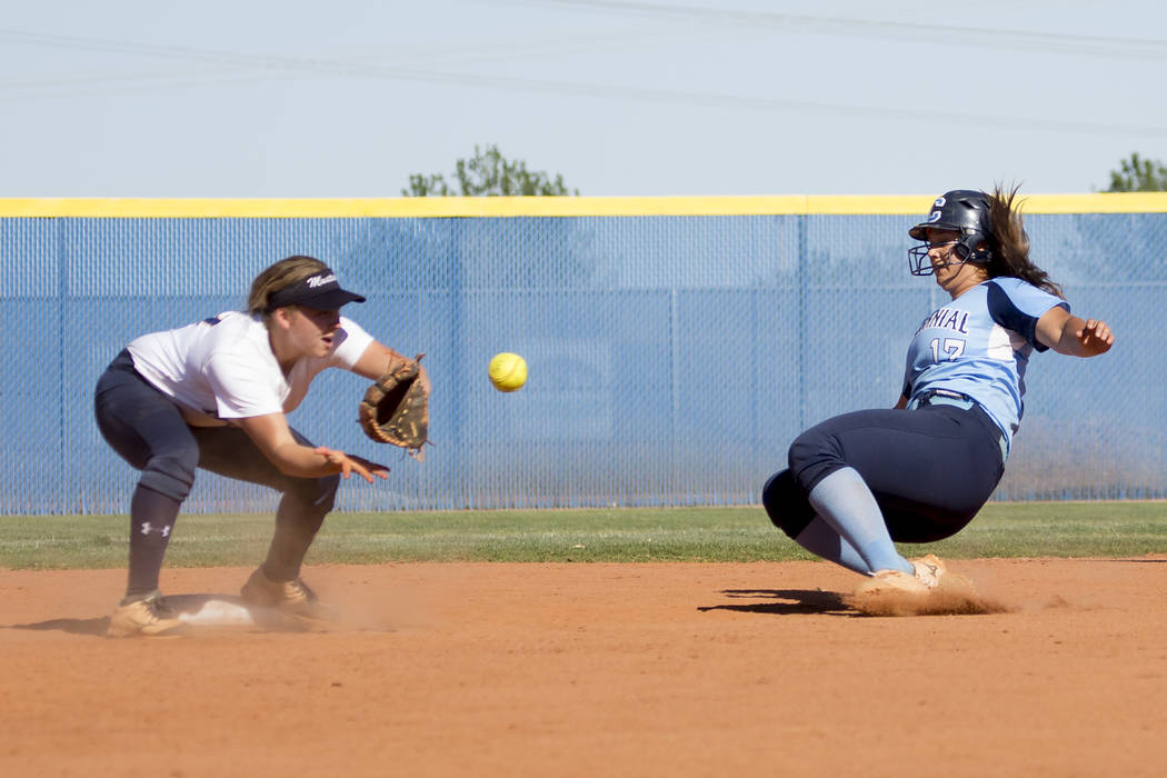 Centennial senior Brianna Benoit, right, slides safely into second for a stolen base as Shadow Ridge junior Alisha Schultz catches the ball during a game at Shadow Ridge High School on Wednesday,  ...
