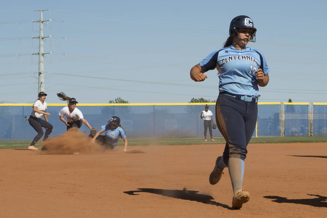 Centennial senior Brianna Benoit comes into third base as teammate senior Haylee Lupinetti slides into second in the background during a game against Shadow Ridge at Shadow Ridge High School on We ...