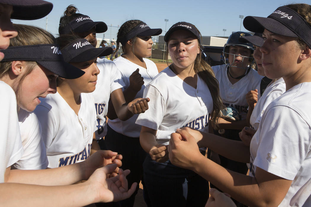 Shadow Ridge teammates gather for a cheer between innings during a a game against Centennial at Shadow Ridge High School on Wednesday, April 19, 2017, in Las Vegas.(Bridget Bennett/Las Vegas Revie ...