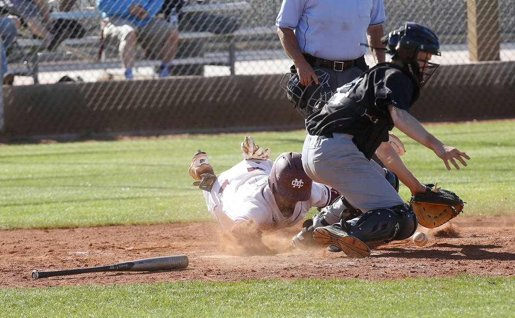 Cimarron-Memorial's Daniel Valdivia (1) is safe at home plate during the fourth inning of a high school baseball game at Cimarron-Memorial High School on Thursday, April 20, 2017, in Las Vegas. Ci ...