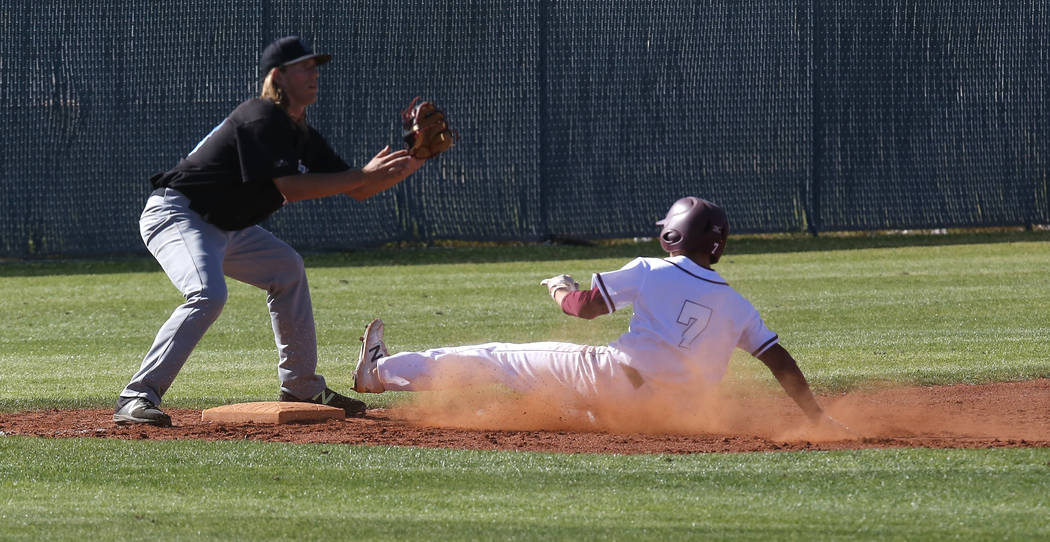 Cimarron-Memorial's Zach Culver (7) slides for third base during the fourth inning of a high school baseball game at Cimarron-Memorial High School on Thursday, April 20, 2017, in Las Vegas. Cimarr ...