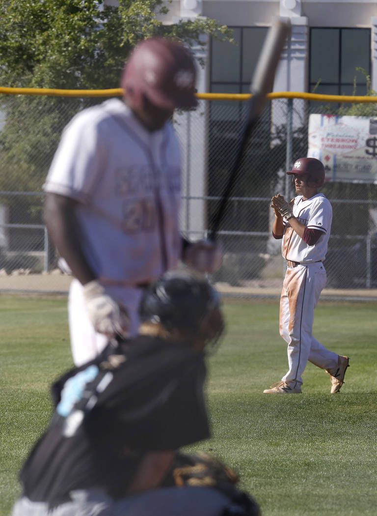 Cimarron-Memorial's Derek Decolati (4) looks to gain a run during the sixth inning of a high school baseball game at Cimarron-Memorial High School on Thursday, April 20, 2017, in Las Vegas. Cimarr ...