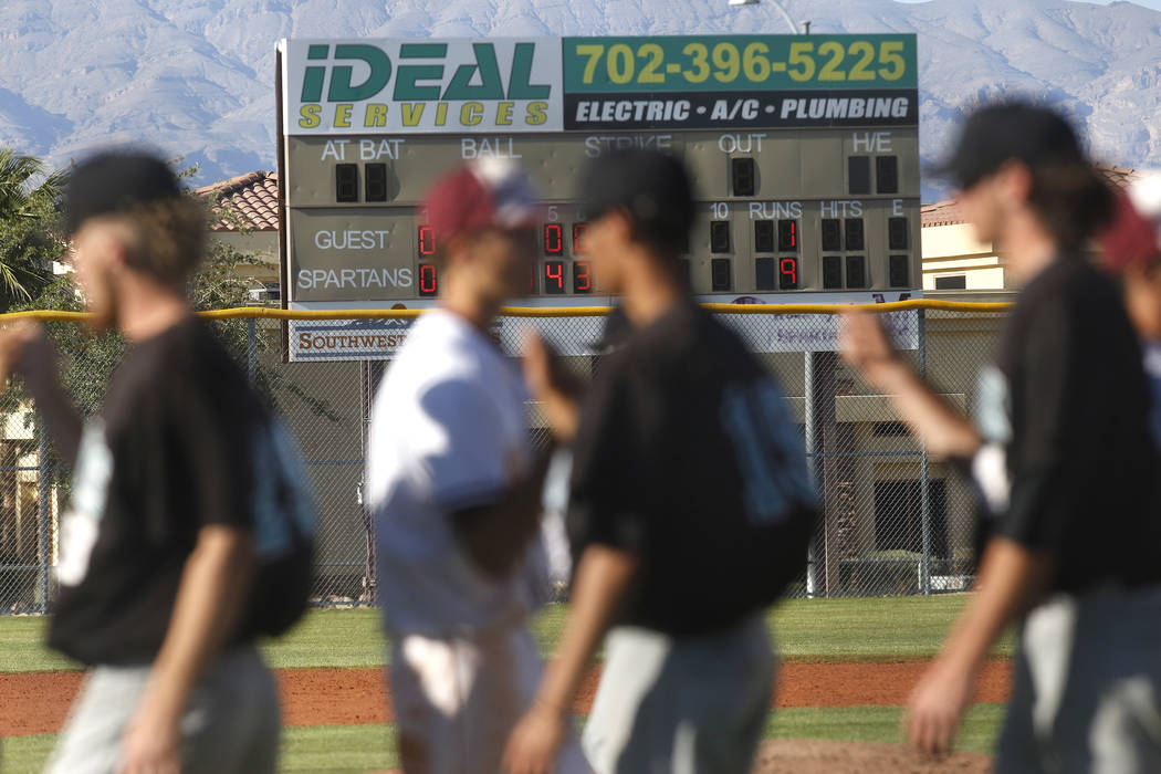 Cimarron-Memorial and Silverado bump fists after a high school baseball game at Cimarron-Memorial High School on Thursday, April 20, 2017, in Las Vegas. Cimarron-Memorial won 9-1. Christian K. Lee ...