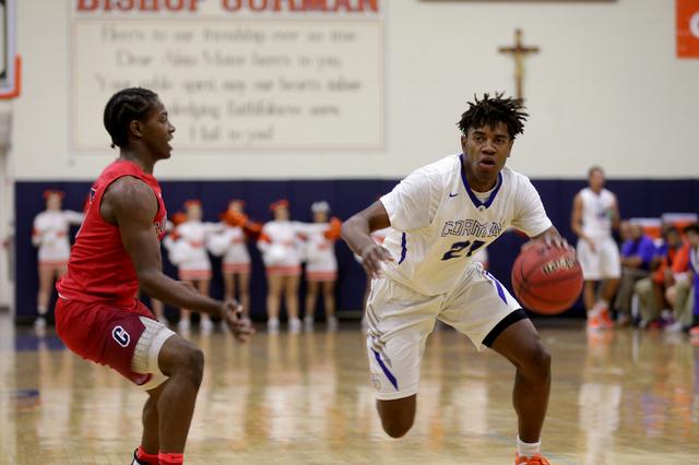 Gorman Bishop's forward Christian Popoola (21) goes to pass Coronado's guard Nick Davis (3) during a basketball game at Bishop Gorman High School on Tuesday, Dec. 6, 2016, in Las Vegas. (Rachel As ...