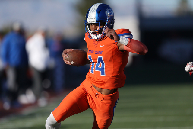 Bishop Gorman's Dorian Thompson-Robinson(14) runs for a touchdown against Liberty in the Class 4A state football championship game at Sam Boyd Stadium on Saturday, Dec. 3, 2016, in Las Vegas. Bish ...