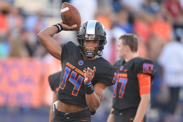 Bishop Gorman quarterback Dorian Thompson-Robinson (14) warms up before the Bishop Gorman High School Kahuku High School game at Bishop Gorman in Summerlin on Saturday, Sept. 17, 2016. Brett Le Bl ...