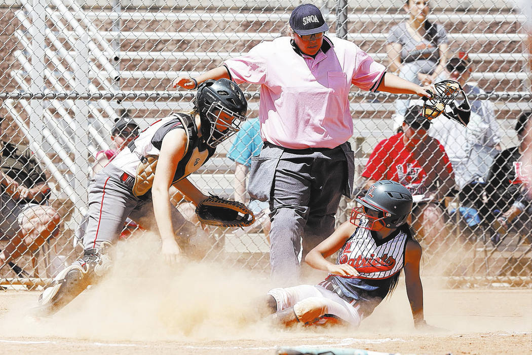 Las Vegas High's, Arienn Ackerman, left, watches as Liberty High's Alyssa Tolentino scores on Saturday, April 22, 2017, in Henderson. Bizuayehu Tesfaye Las Vegas Review-Journal @bizutesfaye